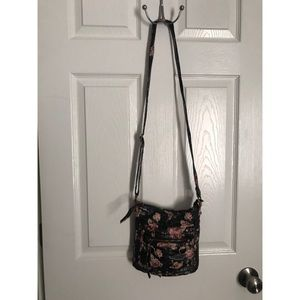Faux leather floral adjustable crossbody purse.